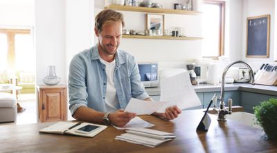 A homeowner looks over his mortgage statements.