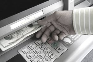 Hand Getting Cash From ATM