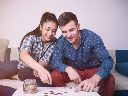 Young couple counting money