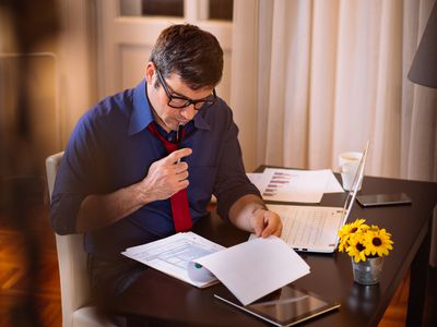 Portrait of hard-working businessman who is working also at home, after hours.
