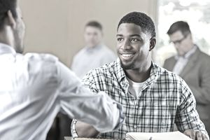 Young Man Shaking Hands With Job Recruiter