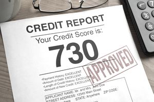 "Credit report with a score of 730 stamped ""Approved."""