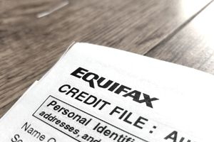 Close-up of the upper corner of a consumer credit report from the credit bureau Equifax