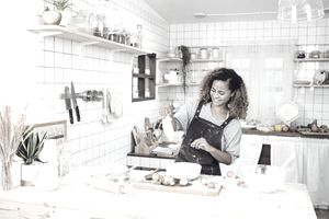 Woman chef cooking at home with pastries