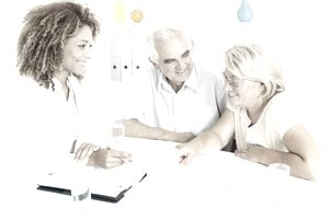 Senior couple discussing their estate plan with financial advisor.