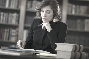 a woman studying in a library