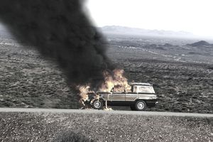 Automobile on fire in desert