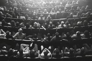 rows of people in a movie theater
