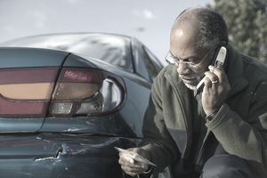 Man Calling In a Car Insurance Claim