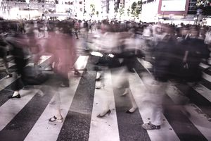 Long exposure picture of people crossing in the scramble crossing of Shibuya at night with nice motion effect.