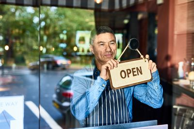 A business owner opens for the day