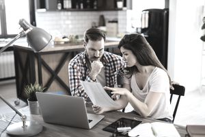 Couple reviewing a financial statement at home