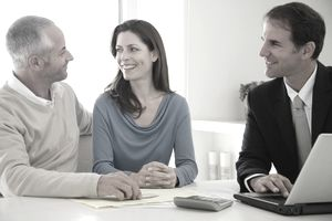 A couple talking to a financial advisor