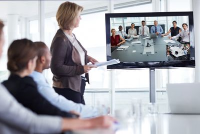 Businesswoman giving presentation in conference room and virtual meeting