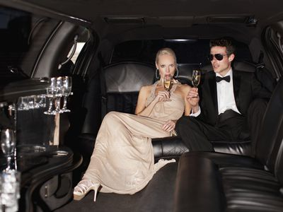 Well dressed couple in limo