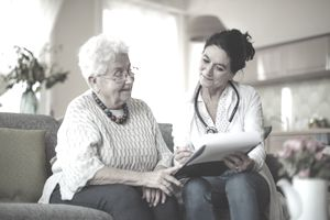 Doctor discussing Blue Cross Medicare Supplemental Insurance Policy benefits to a patient