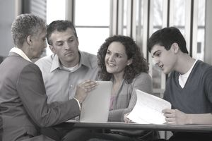 Parents and son talking with financial adviser
