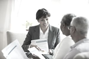 a business woman speaking with an older couple
