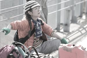 woman sitting on ground after fukushima earthquake
