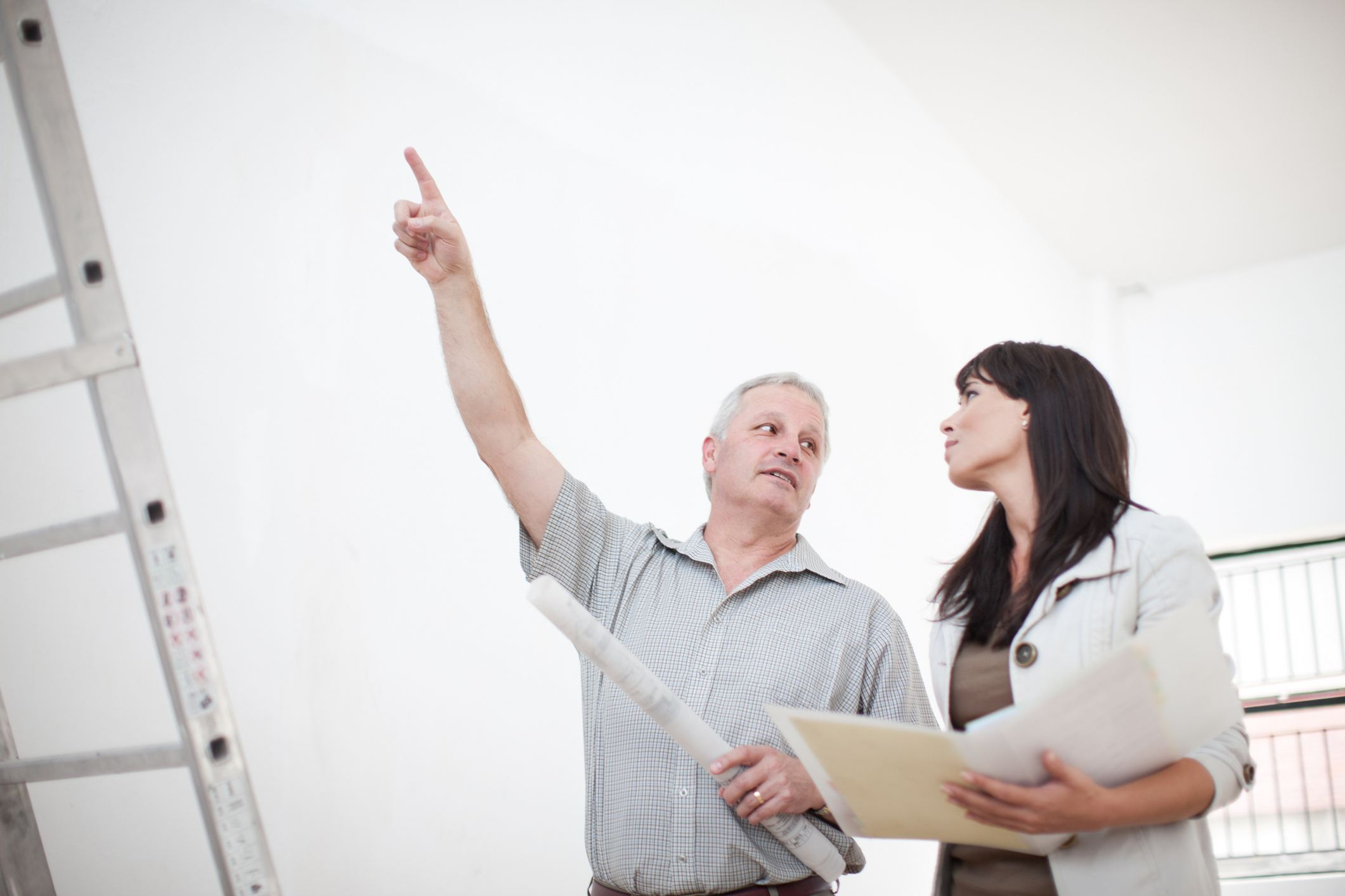 Man and woman inspecting a home