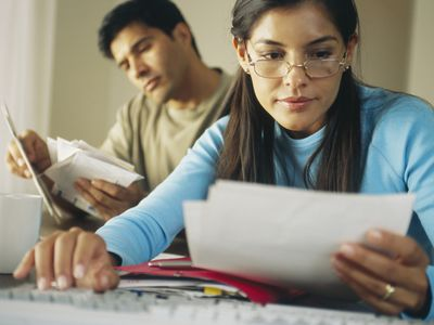 Couple working on refinance paperwork at home