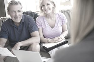 Older couple looking at financial paperwork with an expert adviser.