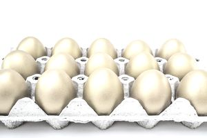 An egg carton filled with golden eggs representing the concept of mutual funds.