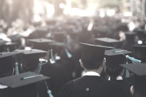 University Students Wearing Mortarboard During Event - stock photo