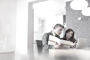 Man and woman at kitchen table discussing a short sale