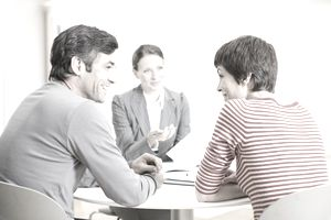 Couple meeting with a businesswoman at a small round table