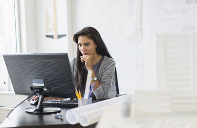 Woman looks over her investment strategy.