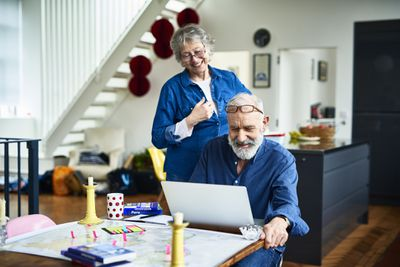 Happy older couple planning at a computer