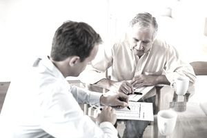 two men going over documents together
