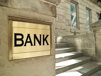 The outside of a bank with a large sign on the front