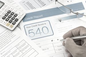person's credit report displaying 540 credit score