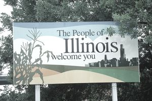 """Welcome to Illinois"" sign on a roadside"