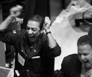 Traders cheer as the Dow briefly moved into positive territory work on the floor of the New York Stock exchange October 10, 2008 in New York City.