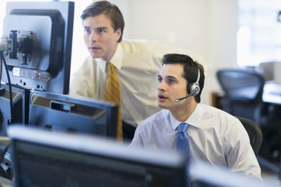 Day traders watching stocks on monitors