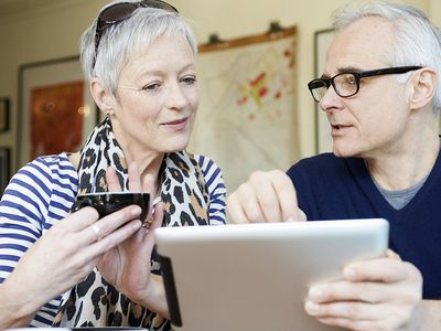 senior couple looking at tablet