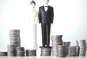 man and woman wedding toppers sitting on coins