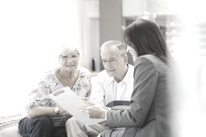 Retirement planner meeting with an older couple