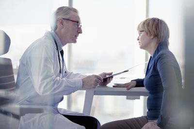Woman talks to her doctor in a medical care facility