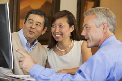 A couple discusses their investments with their adviser