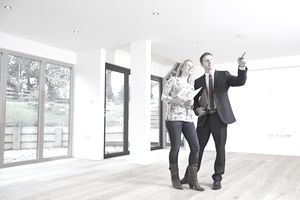 Woman looking at new home with a real estate agent