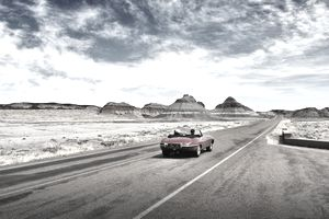 Jaguar XKE driving through the Petrified forest National Park, Arizona