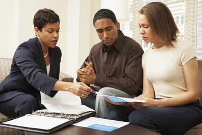Couple with financial planner.