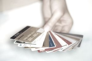 Hand holding array of credit cards