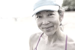Japanese woman smiling on beach
