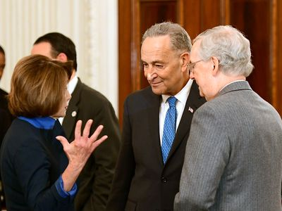 Speaker of the Housr Nancy Pelosi (D-CA), Senate Minority Leader Chuck Schumer (D-NY) and Senate Majority Leader Mitch McConnell (R-KY) attend a reception in the White House January 23, 2017 in Washington, DC.