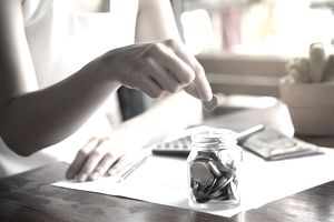 Woman adding change in a jar after canceling her renters insurance